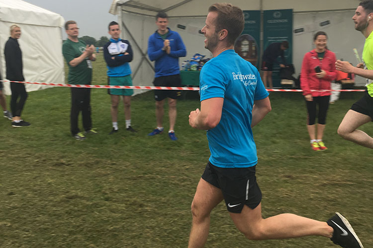 Michael running in the PWC Staff relay